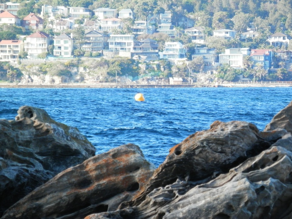 One of the buoys with Shelley Beach in the background (site for the Coles Classic)