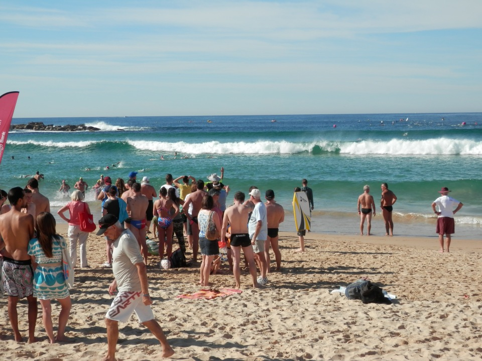 Swimmers catching a wave at the finish