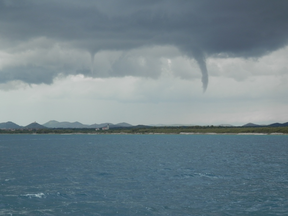Descending funnel over the mainland