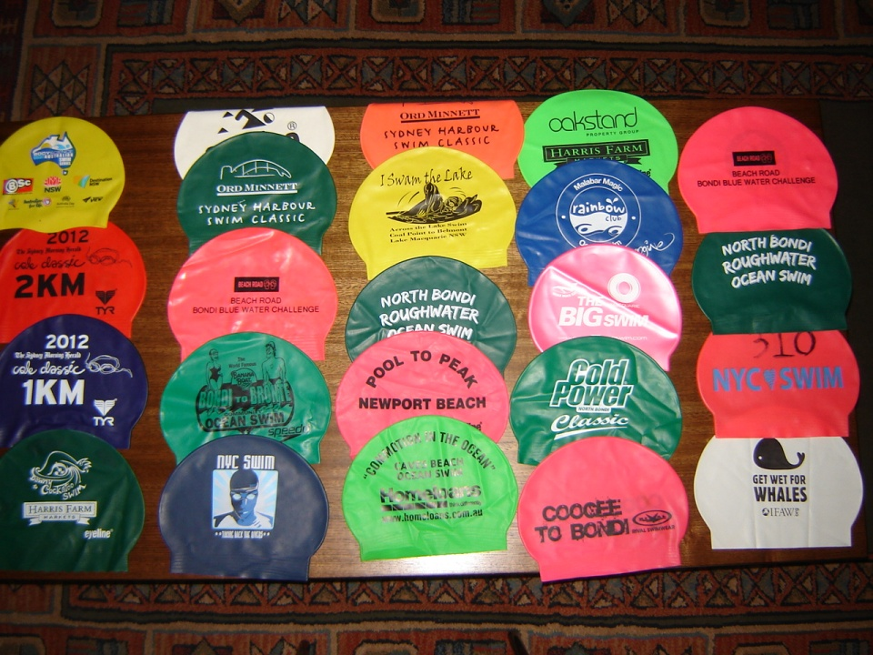 Some of my collection of swim caps
