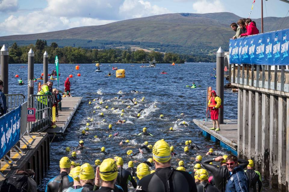 The crush as the swimmers try to enter the water after the start
