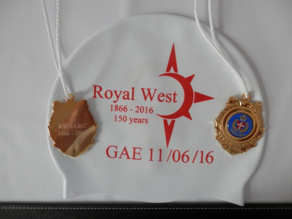 The cap and the medal from the swim
